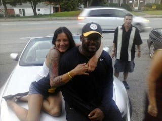 Illustration for article titled Hey, It's Mike Tomlin And Some Tattooed Woman On The Hood Of  A Car