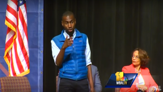 Activist DeRay Mckesson speaks as former Baltimore Mayor Sheila Dixon looks on during a mayoral candidates debate in Baltimore on March 10, 2016.WBAL-TV Baltimore