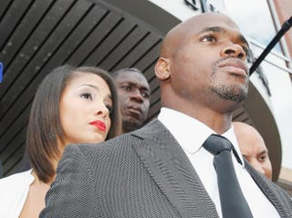 NFL player Adrian Peterson of the Minnesota Vikings waits with his wife, Ashley Brown, after making a court appearance at the Montgomery County Municipal Building Oct. 8, 2014, in Conroe, Texas. Peterson eventually pleaded no contest to misdemeanor reckless assault in a case involving his 4-year-old son.Scott Halleran/Getty Images