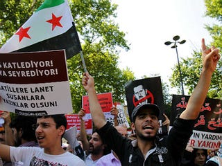 Protestors against Syrian violence (AFP/Getty Images)