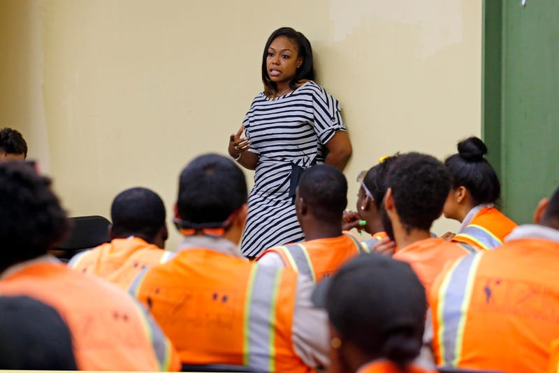 Rodney King's daughter Lora King, 32, speaks to a group of young people who have had their own run-ins with police at a meeting of the Los Angeles Conservation Corps, which provides at-risk youth with job training, education and work, in downtown Los Angeles Thursday, Sept. 15, 2016.