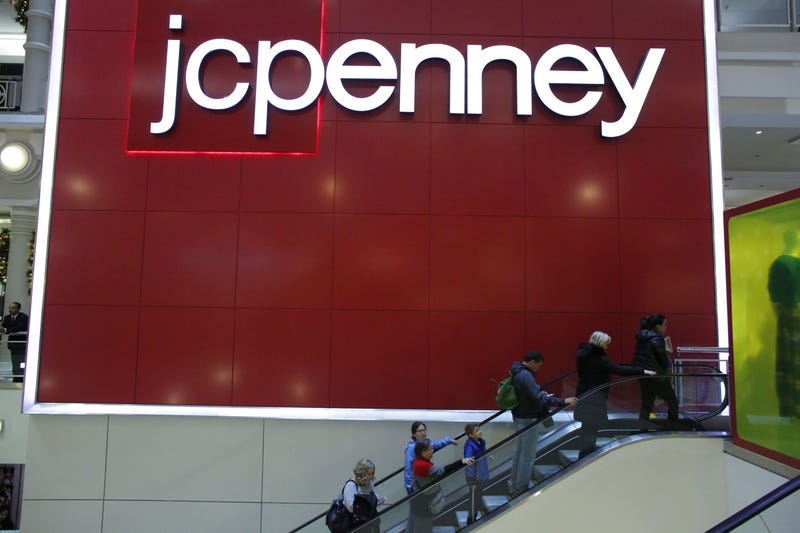 People exit from J.C. Penney store at Herald Square in New York City on Nov. 25, 2016.KENA BETANCUR/AFP/Getty Images