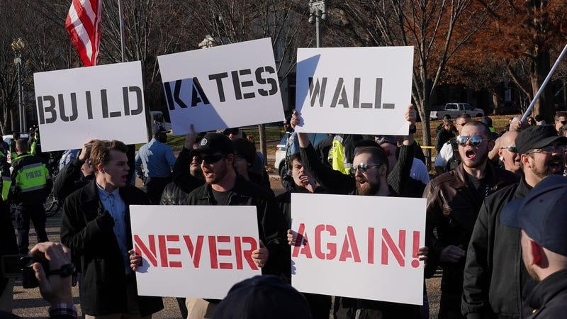 White nationalists hold placards supporting the building of a wall along the U.S.-Mexico border during an anti-immigration rally in front of the White House on Pennsylvania Avenue in Washington, D.C., on Dec. 3, 2017. (Mandel Ngan/Getty Images)