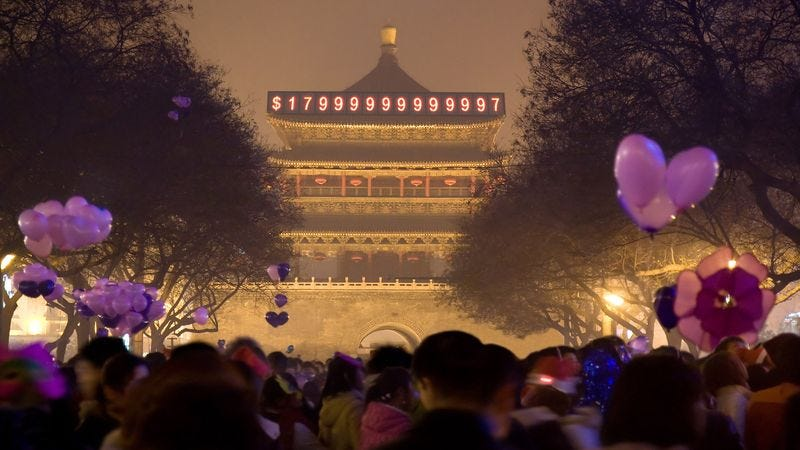 Illustration for article titled Chinese Citizens Gather In Beijing Square To Watch U.S. National Debt Clock Strike $18 Trillion