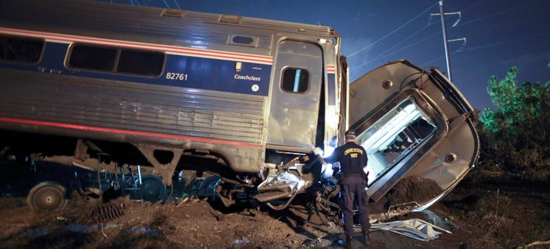 Emergency personnel work the scene of a deadly train wreck in Philadelphia in May 2015. (AP Photo/Joseph Kaczmarek)