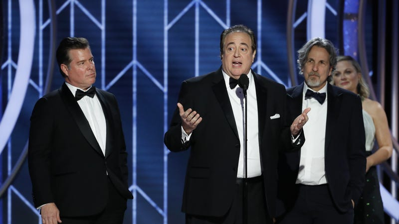 "In this handout photo provided by NBCUniversal, Brian Currie, Nick Vallelonga and Peter Farrelly of ""Green Book"" accept the Best Screenplay – Motion Picture award onstage during the 76th Annual Golden Globe Awards on January 06, 2019 in Beverly Hills, California."