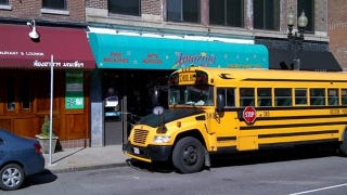 Illustration for article titled This Is A School Bus Parked In Front Of A Porn Store
