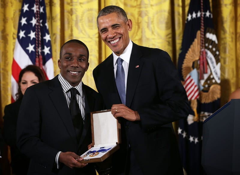 Andre Dubois, grandnephew of former U.S. Rep. Shirley Chisholm (D-N.Y.), receives the Presidential Medal of Freedom on behalf of the late congresswoman from  President Barack Obama during an East Room ceremony at the White House in Washington, D.C., on Nov. 24, 2015.Alex Wong/Getty Images