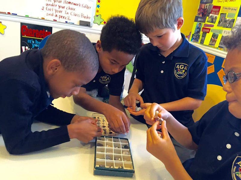 Students at the Atlanta Gifted Academy participate in a small group experiment with metamorphic, igneous and volcanic rocks.Courtesy of the Atlanta Gifted Academy