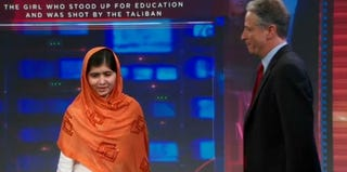 Malala Yousafzai is greeted by Jon Stewart on The Daily Show. (Screenshot from The Daily Show/Comedy Central)