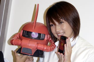 Illustration for article titled Japan Gets a Zaku 2-Style Helmet Phone from Sharp and Softbank