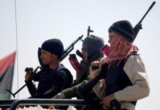 Libyan rebels deploy at the western gate of the strategic restivetown of Ajdabiya. (Marwan Naamani/AFP/Getty Images)