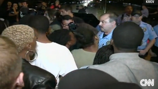 Protesters confront St. Louis police after reports that an off-duty officer fatally shot an 18-year-old black man.CNN
