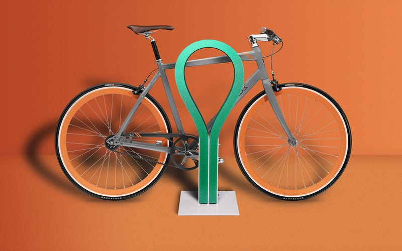 Illustration for article titled This Colorful Rubber Bike Rack Won't Scratch Or Ding Your Favorite Ride