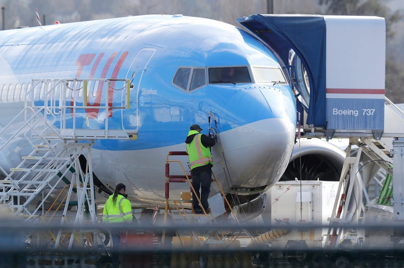 A worker stands on a platform near a Boeing 737 MAX 8 airplane being built for TUI Group at Boeing Co.'s Renton Assembly Plant Wednesday, March 13, 2019, in Renton, Wash.