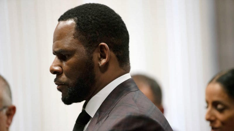 R. Kelly appears at a court hearing in Chicago June 26, 2019, on state charges he faces involving allegations of multiple sex crimes. Now, Kelly faces additional federal charges.