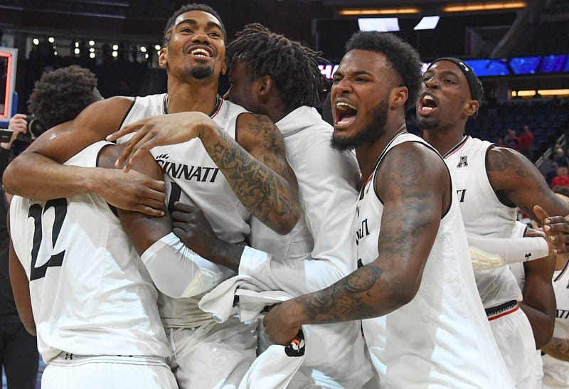 The Cincinnati Bearcats celebrate their championship victory over the Houston Cougars in the 2018 AAC Basketball Championship on March 11, 2018, in Orlando, Fla.