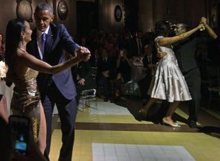 President Barack Obama (left) and first lady Michelle Obama (second from right) dance the tango with other partners during a state dinner at the Kirchner Cultural Centre in Buenos Aires, Argentina, on March 23, 2016.NICHOLAS KAMM/AFP/Getty Images