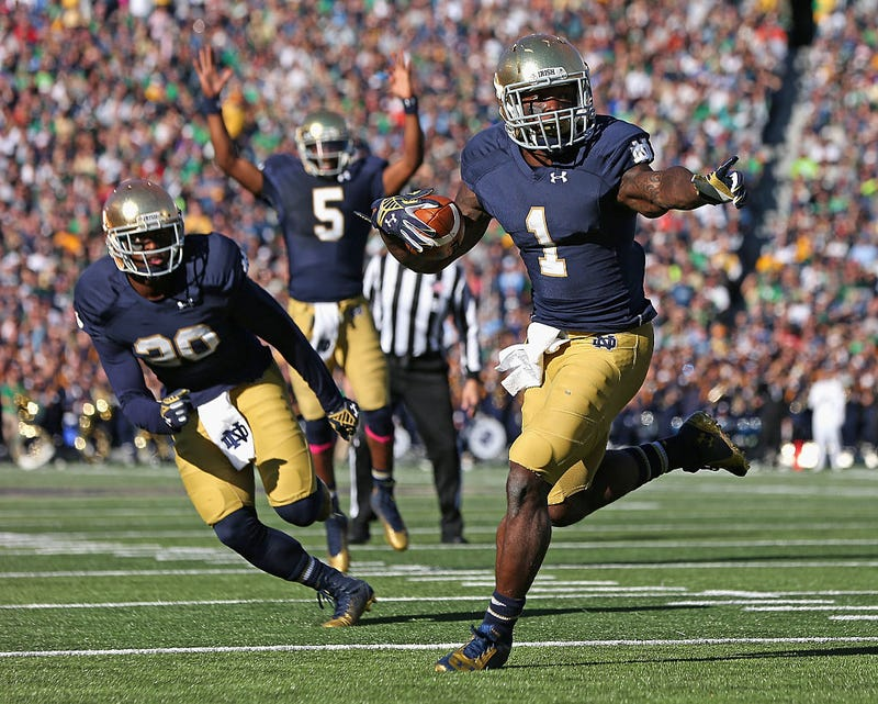 Greg Bryant runs for a touchdown in front of C.J. Prosise #20 as Evertt Golson #5 signals the score against the North Carolina Tar Heels at Notre Dame Stadium on October 11, 2014 in South Bend, Indiana. Via Getty.