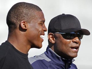 Cam Newton and his adviser Hall of Fame Quarterback Warren Moon