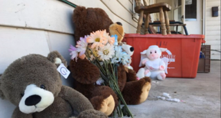 Part of a memorial set up at the house where the four children were found unconsciousWHIO News