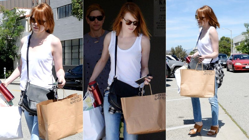 Illustration for article titled Why Is Emma Stone Carrying a Bag with Andrew Garfield's Name On It?