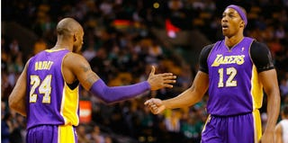 Kobe Bryant and Dwight Howard (Jared Wickerham/Getty Images)