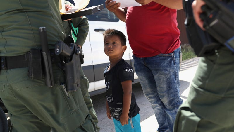 A boy and father from Honduras are taken into custody by U.S. Border Patrol agents near the U.S.-Mexico border near Mission, Texas.