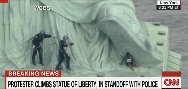 Illustration for article titled Woman Arrested on 4th of July After Climbing the Base of the Statue of Liberty in Protest of Migrant Family Separations