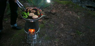 Illustration for article titled BioLite's BaseCamp Stove Grills Your Food and Charges Your Gadgets