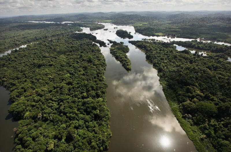 The Xingu River flows near the area where the Belo Monte dam complex is under construction in the Amazon basin on June 15, 2012 near Altamira, Brazil. Belo Monte will be the world's third-largest hydroelectric project and will displace up to 20,000 people while diverting the Xingu River and flooding as much as 230 square miles of rainforest.