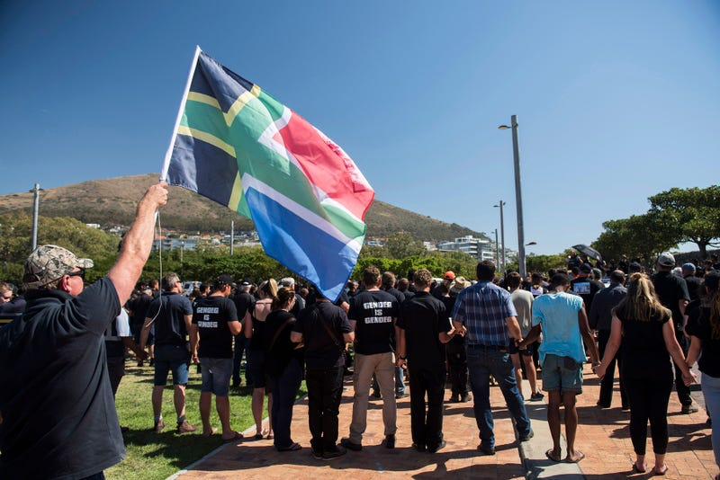 A protester waves a flag during a demonstration by South African farmers and farmworkers to protest against farmer murders in the country on Oct. 30, 2017, in Cape Town, South Africa.