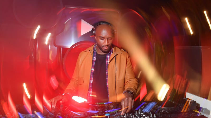 Virgil Abloh performs on stage at the YouTube cocktail party during Paris Fashion Week on Sept. 26, 2018, in Paris.