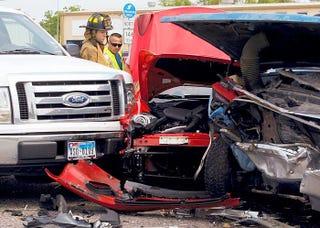 Illustration for article titled Texan Suburban crashes into Ferrari California
