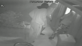 Surveillance footage shows three masked men breaking into the home of a Bradenton, Fla., couple July 9, 2015.YouTube screenshot
