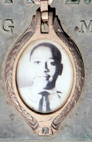 A photo of Emmett Till is included on the plaque that marks his gravesite at Burr Oak Cemetery, May 4, 2005, in Aslip, Ill.Scott Olson/Getty Images