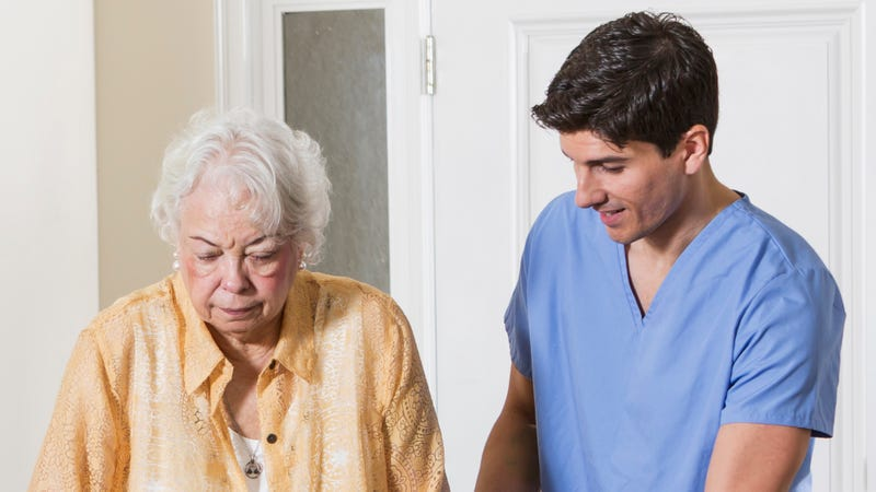 Illustration for article titled Family Unsure Why Grandmother's Caregiver Seems Like He Actually Enjoys Spending Time With Her