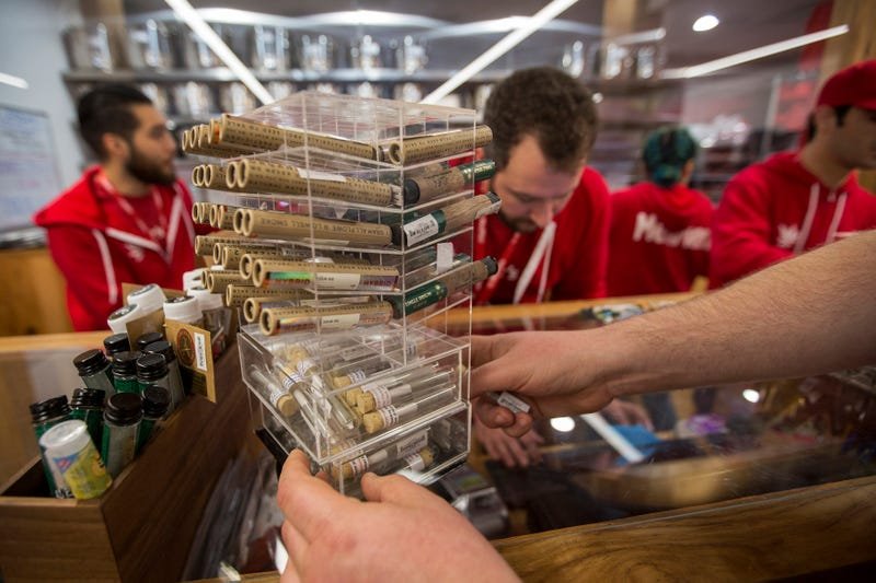 A customer reaches for cannabis products at MedMen, one of the two Los Angeles area pot shops that began selling marijuana for recreational use under the new California marijuana law on January 2, 2018 in West Hollywood, California.