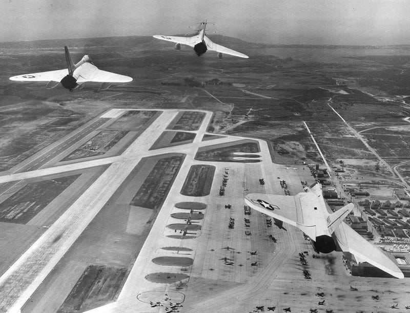 """U.S. Navy Douglas F4D-1 Skyrays of Fighter Squadron 74 (VF-74) """"Be-Devilers"""" during a fly over of Naval Air Station Miramar, California, on 14 May 1956."""