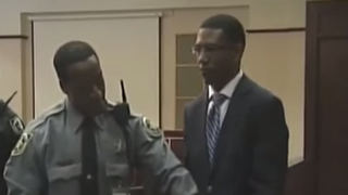 Dante Martin (right) stands aside a Florida law-enforcement official.YouTube