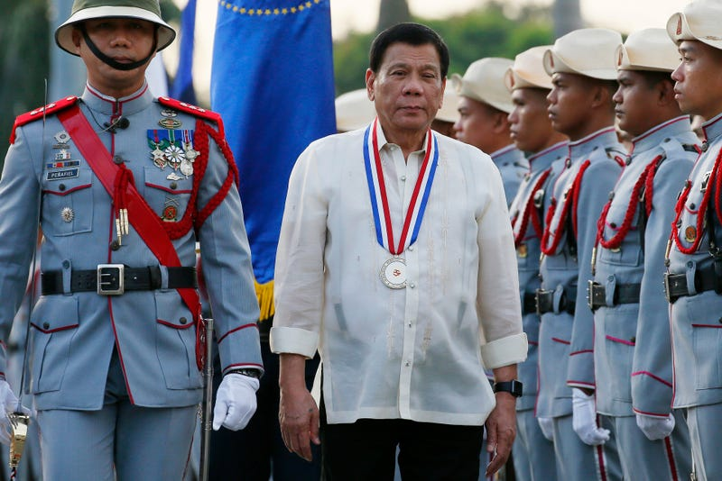 Philippine President Rodrigo Duterte reviews the troops as he leads the flag-raising ceremony to commemorate the 120th death anniversary of the country's national hero Jose P. Rizal Friday, Dec. 30, 2016 in Manila, Philippines. Détente remains popular as shown by recent surveys despite international concerns about his war on drugs that has so far killed more than 6,000 drug suspects since he took office June 30. (AP Photo/Bullit Marquez)
