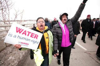 People in Flint, Mich., participate in a national mile-long march, organized in part by the Rev. Jesse Jackson, to highlight the push for clean water in the city on Feb. 19, 2016.Bill Pugliano/Getty Images