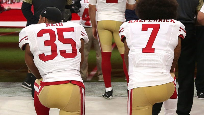 Eric Reid, No. 35, and Colin Kaepernick, No. 7, both then of the San Francisco 49ers, kneel in protest during the national anthem prior to playing the Los Angeles Rams in their NFL game at Levi's Stadium on Sept. 12, 2016, in Santa Clara, Calif. (Thearon W. Henderson/Getty Images)
