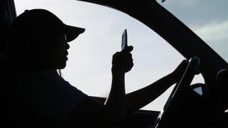 Illustration for article titled Man Loses License After Using Two Cell Phones While Driving