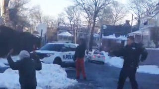 Police in New Rochelle, N.Y., draw guns on teens to stop a snowball fight.YouTube Screenshot