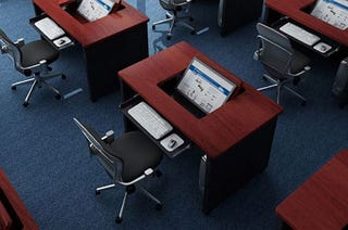 Illustration for article titled Revolution Desk Saves Space With a Fold-Away Workstation