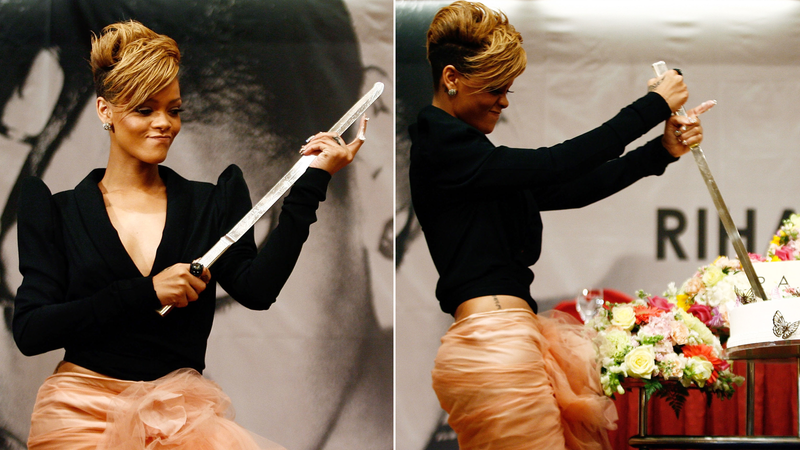 Rihanna uses a saber to slice a birthday cake at a Rated R release party in Seoul, February 10, 2010. Image via Getty.
