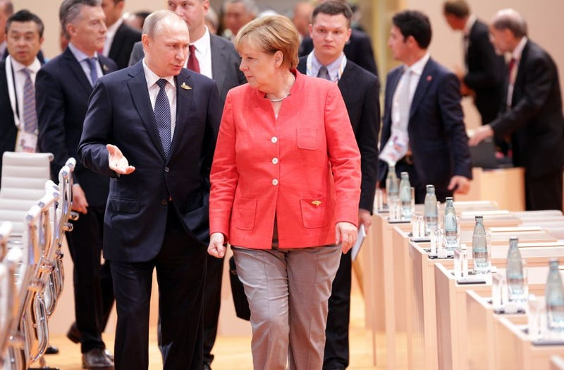 German Chancellor Angela Merkel and Russian President Vladimir Putin attend the first session of the G-20 summit July 7, 2017, in Hamburg, Germany. (Thorsten Gutschalk-Pool/Getty Images)
