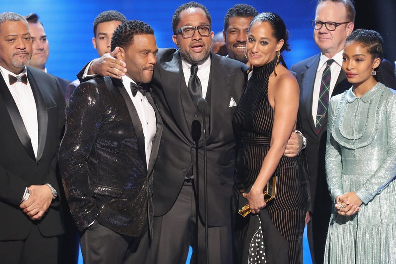 Black-ish creator Kenya Barris (center) with his show colleagues (from left) Laurence Fishburne, Anthony Anderson, Tracee Ellis Ross, and Yara Shahidi, accepting the award for Outstanding Comedy Series at the NAACP Image Awards Feb. 11, 2017, in Pasadena, Calif.