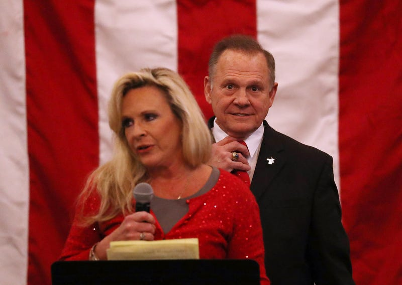 Republican senatorial candidate Roy Moore stands behind his wife, Kayla Moore, as she speaks during a campaign event at Jordan's Activity Barn in Midland City, Ala., on Dec. 11, 2017. (Joe Raedle/Getty Images)